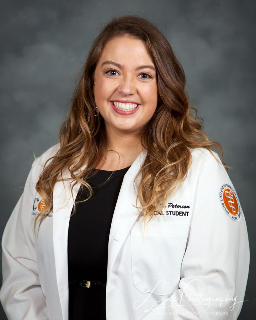 female medical student's official white coat headshot