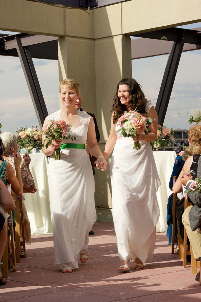 same sex wedding ceremony at the CW Moore Penthouse in Boise