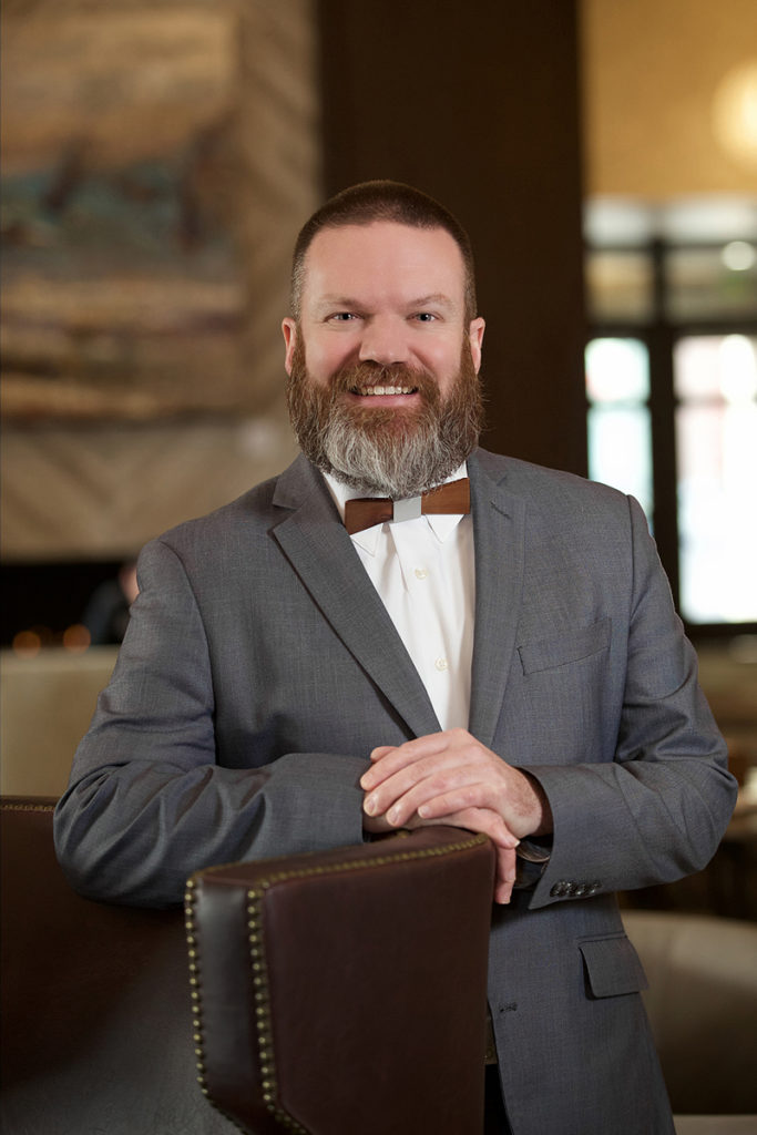 hotel employee photographed in Boise hotel lobby wearing a suit and bowtie
