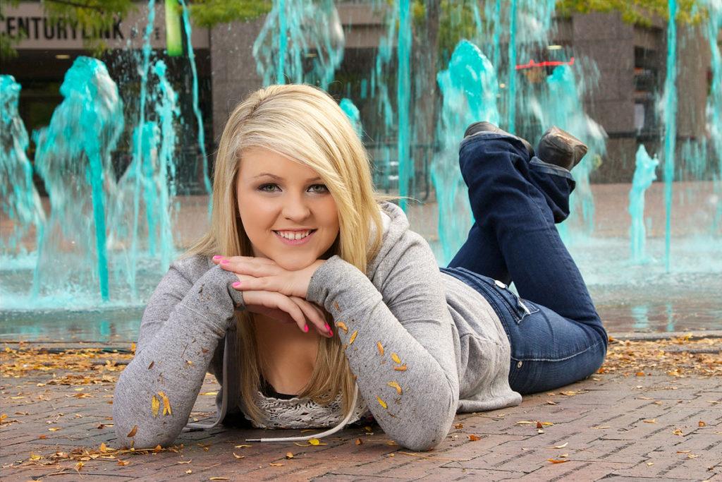 professional photo studio senior photos of blonde female on ground