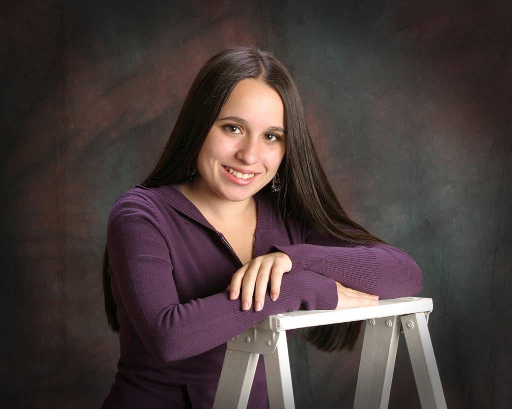 studio photos of female senior graduate