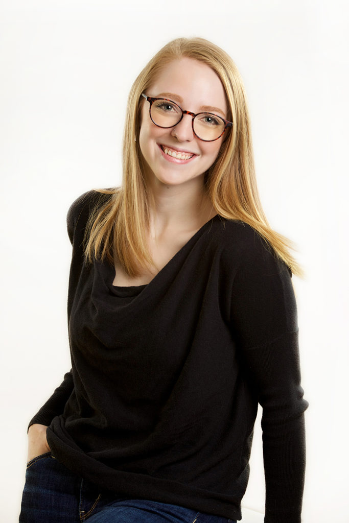 casual studio portrait of a female photographed in the photo studio on a white seamless backdrop
