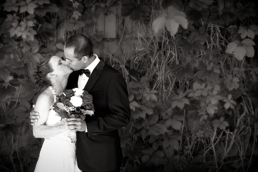 wedding picture of couple kissing
