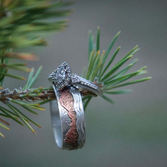 wedding rings on pine