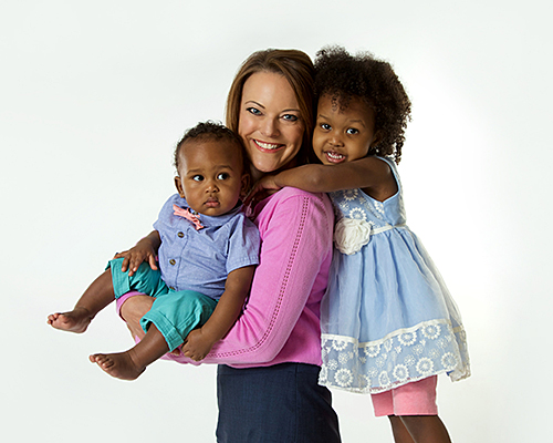 TV Anchor surrounded by babies