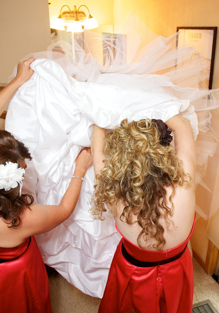 idaho bride getting into her bridal gown
